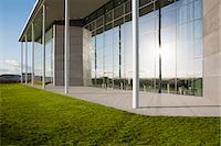 Modern building and green lawn Stock Photo - Premium Royalty-Freenull, Code: 6113-06721427