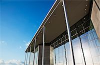 Modern building and blue sky Stock Photo - Premium Royalty-Freenull, Code: 6113-06721428
