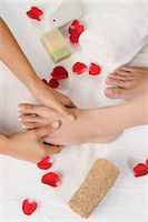 foot massage - Woman receiving pedicure treatment at health spa Stock Photo - Premium Royalty-Freenull, Code: 630-06721866