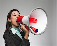 Businesswoman shouting into a megaphone Stock Photo - Premium Royalty-Freenull, Code: 630-06721992