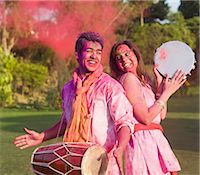 Couple celebrating Holi with musical instruments in a garden Stock Photo - Premium Royalty-Freenull, Code: 630-06722097