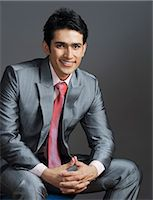east indian (male) - Portrait of a businessman smiling Stock Photo - Premium Royalty-Freenull, Code: 630-06722209