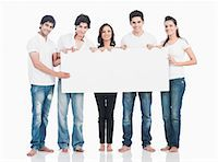 person holding sign - Friends holding a whiteboard and smiling Stock Photo - Premium Royalty-Freenull, Code: 630-06722433