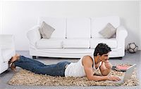 east indian (male) - Man using a laptop on the floor Stock Photo - Premium Royalty-Freenull, Code: 630-06722634