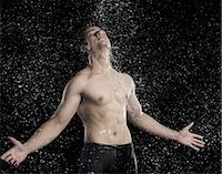 east indian (male) - Bare chested man splashed with water Stock Photo - Premium Royalty-Freenull, Code: 630-06722701