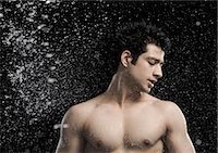 Bare chested man splashed with water Stock Photo - Premium Royalty-Freenull, Code: 630-06722704