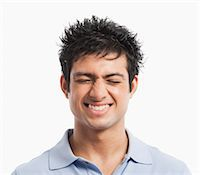 Close-up of a man squinting and smiling Stock Photo - Premium Royalty-Freenull, Code: 630-06722709