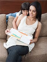 Girl showing drawing of Indian flag to her mother Stock Photo - Premium Royalty-Freenull, Code: 630-06722993