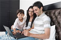 Man doing online shopping with his family Stock Photo - Premium Royalty-Freenull, Code: 630-06723107