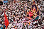 Crowd at religious procession during Ganpati visarjan ceremony, Mumbai, Maharashtra, India