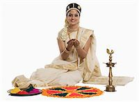 Indian woman in traditional clothing praying with an oil lamp at Durga puja festival Stock Photo - Premium Royalty-Freenull, Code: 630-06723378