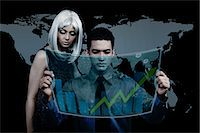 Business people watching stock market graph on a virtual screen Stock Photo - Premium Royalty-Freenull, Code: 630-06723512