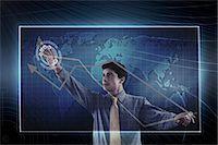 futuristic - Businessman using a virtual screen Stock Photo - Premium Royalty-Freenull, Code: 630-06723524