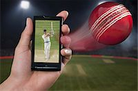 streaming - Man watching a cricket match on a mobile phone Stock Photo - Premium Royalty-Freenull, Code: 630-06724640