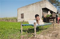 farm phone - Farmer using a laptop and talking on a mobile phone in the field, Sonipat, Haryana, India Stock Photo - Premium Royalty-Freenull, Code: 630-06724661
