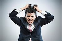 east indian (male) - Businessman pulling his hair in frustration Stock Photo - Premium Royalty-Freenull, Code: 630-06724728