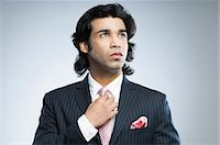Close-up of a businessman adjusting his tie Stock Photo - Premium Royalty-Freenull, Code: 630-06724743