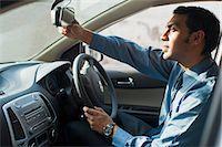 Bengali businessman driving a car Stock Photo - Premium Royalty-Freenull, Code: 630-06724896