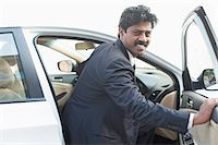 South Indian businessman coming out from the car Stock Photo - Premium Royalty-Freenull, Code: 630-06724902