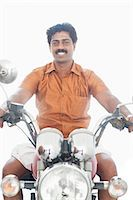 South Indian man riding a motorcycle Stock Photo - Premium Royalty-Freenull, Code: 630-06724915