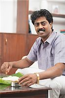 South Indian man having food Stock Photo - Premium Royalty-Freenull, Code: 630-06724924