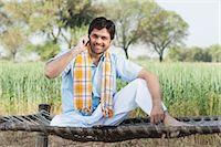 farm phone - Farmer talking on a mobile phone in the field, Sohna, Haryana, India Stock Photo - Premium Royalty-Freenull, Code: 630-06724944
