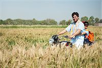 riding crop - Farmer with his daughter riding a motorcycle in the field, Sohna, Haryana, India Stock Photo - Premium Royalty-Freenull, Code: 630-06724952