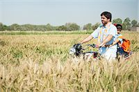 riding crop - Farmer with his daughter riding a motorcycle in the field, Sohna, Haryana, India Stock Photo - Premium Royalty-Freenull, Code: 630-06724953