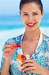 Beautiful brunette eating fruit on beach Stock Photo - Premium Rights-Managed, Artist: urbanlip.com, Code: 847-06727288