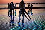 Croatia, Dalmatia, Solar panels as a dance floor, sunset in background