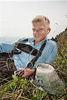 Germany, Bavaria,Boy with headphones takes a rest in mountains Stock Photo - Premium Royalty-Freenull, Code: 6115-06733164