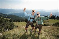 preteen dancing - Germany, Bavaria, Two boys in traditional clothing fooling around in mountains Stock Photo - Premium Royalty-Freenull, Code: 6115-06733167