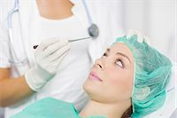 facial - Patient Getting A Cosmetic Surgery Treatment Stock Photo - Premium Royalty-Freenull, Code: 6115-06733252