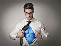 Office worker with glasses opening his shirt like a superhero Stock Photo - Royalty-Freenull, Code: 400-06733528