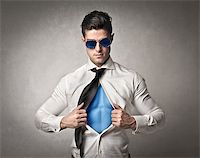 Office worker with sunglasses opening his shirt like superman Stock Photo - Royalty-Freenull, Code: 400-06733530