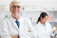 Pharmacist looking at camera with arms crossed in hospital Stock Photo - Royalty-Freenull, Code: 400-06734745