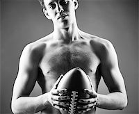 Image of topless man holding rugby ball in isolation Stock Photo - Royalty-Freenull, Code: 400-06742203