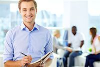 planner - Portrait of a business guy writing in his organizer Stock Photo - Royalty-Freenull, Code: 400-06742412