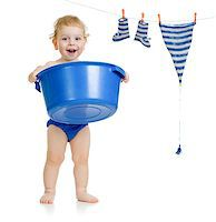 Happy kid washing his accessories Stock Photo - Royalty-Freenull, Code: 400-06747115