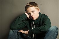 Portrait of Boy Leaning on Hand, Studio Shot Stock Photo - Premium Royalty-Freenull, Code: 600-06752472
