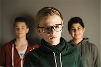 Head and Shoulder Portrait of Teenage Boys, Studio Shot Stock Photo - Premium Royalty-Freenull, Code: 600-06752473