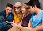 Teenagers looking at Tablet PC, Studio Shot Stock Photo - Premium Royalty-Free, Artist: Uwe Umstätter, Code: 600-06752514