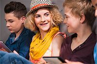 Teenagers with Tablet PC, Studio Shot Stock Photo - Premium Royalty-Freenull, Code: 600-06752515