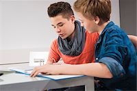 Teenage Boys Studying Together, Studio Shot Stock Photo - Premium Royalty-Freenull, Code: 600-06752518