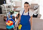 Maid smiling in living room Stock Photo - Premium Royalty-Freenull, Code: 6113-06753203