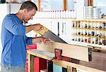 Man working in workshop Stock Photo - Premium Royalty-Free, Artist: Blend Images, Code: 6113-06753279