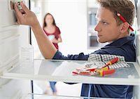 fridge - Electrician working on fridge in home Stock Photo - Premium Royalty-Freenull, Code: 6113-06753284