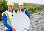 Workers installing satellite dish on roof Stock Photo - Premium Royalty-Free, Artist: Blend Images, Code: 6113-06753315