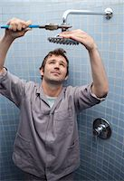 shower - Plumber working on shower head in bathroom Stock Photo - Premium Royalty-Freenull, Code: 6113-06753330