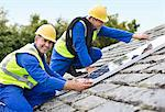 Workers installing solar panels on roof Stock Photo - Premium Royalty-Free, Artist: Robert Harding Images, Code: 6113-06753333